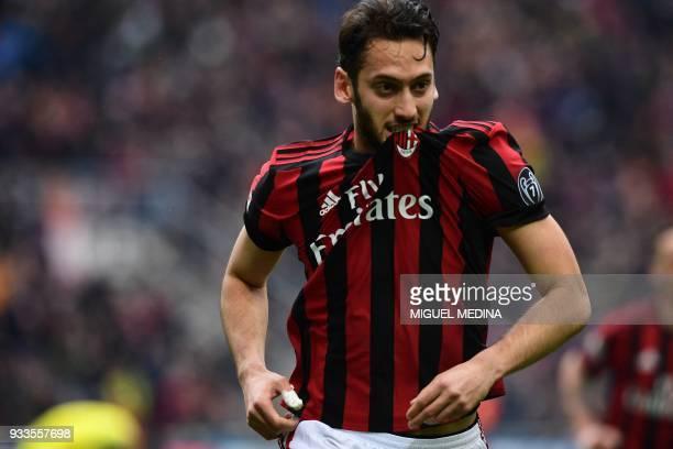 AC Milan's German midfielder Hakan Calhanoglu celebrates after scoring during the Italian Serie A football match AC Milan vs AC Chievo at the San...