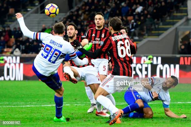 AC Milan's German midfielder Hakan Calhanoglu vies with Sampdoria's Uruguayan midfielder Gaston Ramirez during the Italian Serie A football match...