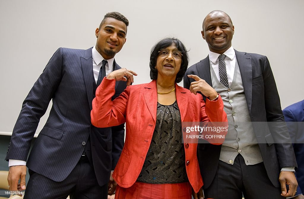 AC Milan's Ghana international Kevin-Prince Boateng (L) and former France captain Patrick Vieira (R) pose with United Nations High Commissioner for Human Rights Navi Pillay (C) prior to the opening of a the panel discussion on racism and sport on March 21, 2013 at the United Nations Office in Geneva, Boateng, lauded by anti-racism campaigners since he walked off a football pitch during a club game in Italy to protest abuse by fans, joined Vieira and officials from FIFA, UEFA and the United Nations to discuss how to rid sport of the problem.