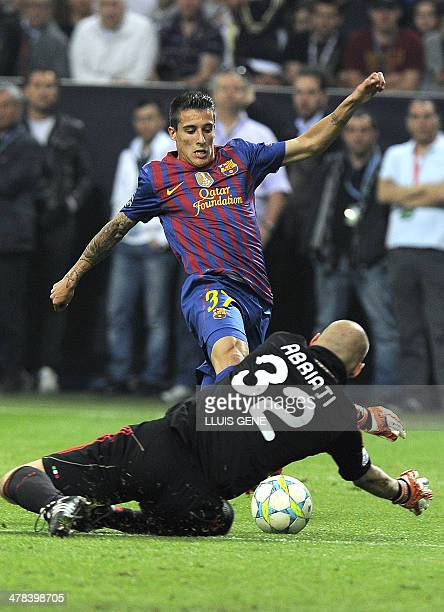 Milan's goalkeeper Christian Abbiati fights for the ball with Barcelona's midfielder Cristian Tello the Champions League quarter-finals first leg...