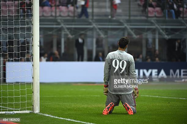 Milan's goalkeeper from Italy Gianluigi Donnarumma reacts after a goal during the Italian Serie A football match AC Milan vs Sassuolo on October 25,...