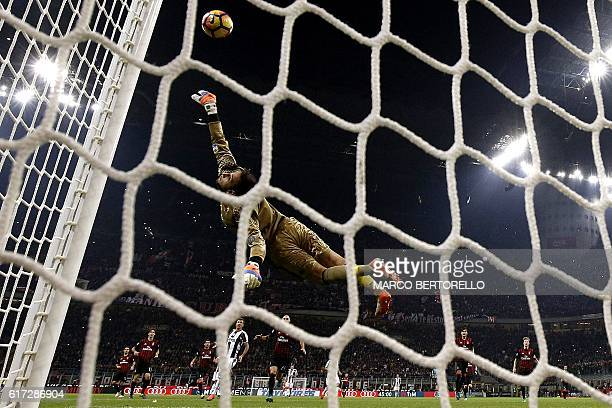 Milan's goalkeeper Gianluigi Donnarumma saves a goal during the Italian Serie A football match AC Milan versus Juventus on October 22 2016 at the San...