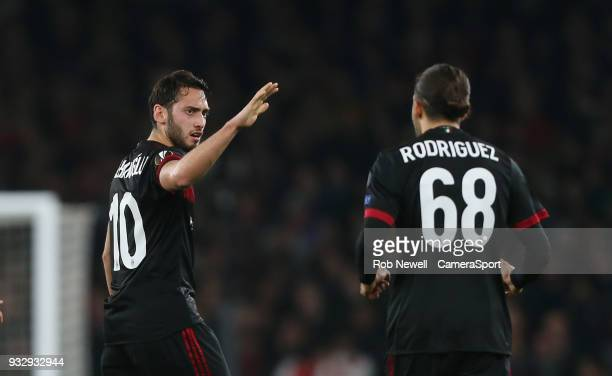 Milan's Hakan Calhanoglu celebrates scoring his side's first goal during the Europa League Round of 16 Second Leg match between Arsenal and AC Milan...