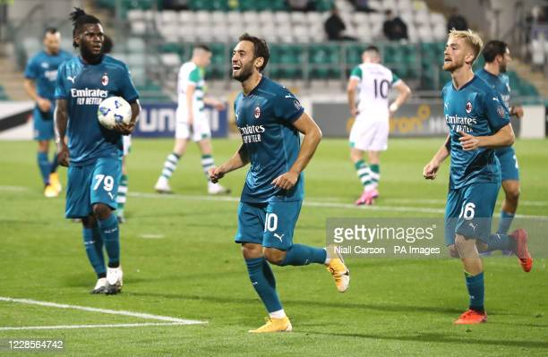 Milan's Hakan Calhanoglu celebrates scoring his side's second goal of the game during the UEFA Europa League, Second Qualifying Round match at...