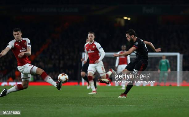 Milan's Hakan Calhanoglu scores his side's first goal during the Europa League Round of 16 Second Leg match between Arsenal and AC Milan at Emirates...