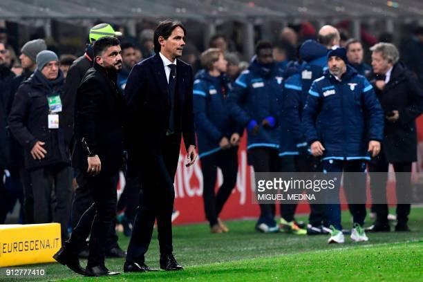 AC Milan's Italian coach Gennaro Gattuso and Lazio's Italian coach Simone Inzaghi meet at the end of the Italian Serie A football match between AC...