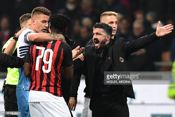 AC Milan's Italian coach Gennaro Gattuso and Lazio's Serbian midfielder Sergej MilinkovicSavic intervene to put an end to a scuffle between Lazio's...