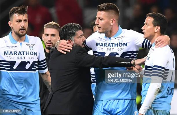 AC Milan's Italian coach Gennaro Gattuso and Lazio's Serbian midfielder Sergej MilinkovicSavic intervene to put an end to a scuffle between Lazio's...
