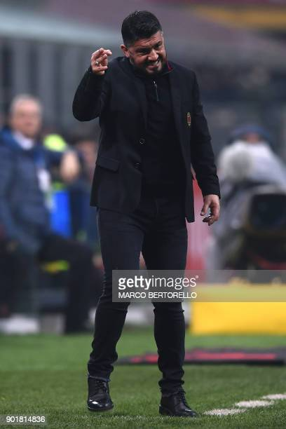 AC Milan's Italian coach Gennaro Gattuso gestures during the Italian Serie A football match AC Milan vs Crotone on January 6 2018 at the San Siro...