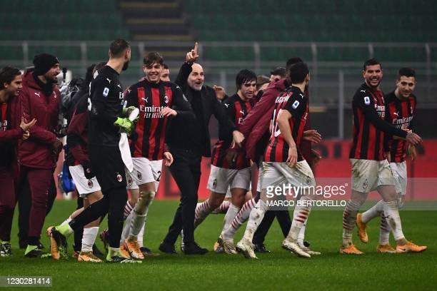 Milan's Italian coach Stefano Pioli , AC Milan's Italian forward Daniel Maldini , AC Milan's French defender Theo Hernandez and teammates celebrate...