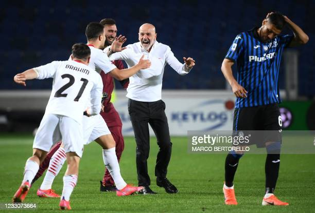 Milan's Italian coach Stefano Pioli celebrates after AC Milan secured their qualification for the Champions League at the end of the Italian Serie A...
