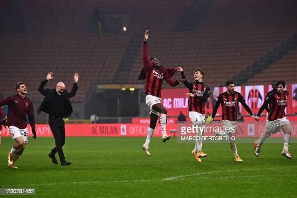 Milan's Italian coach Stefano Pioli celebrates with AC Milan's Portuguese forward Rafael Leao , AC Milan's Italian forward Daniel Maldini , AC...