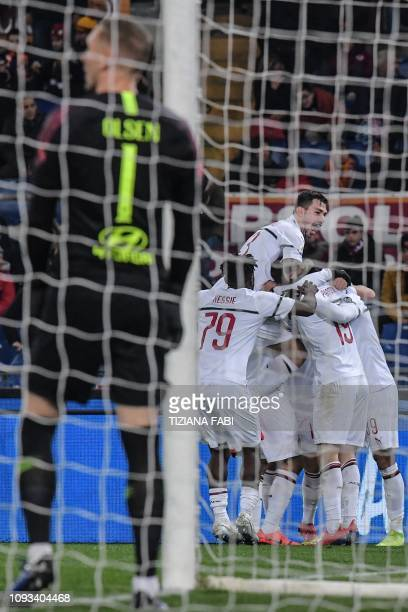 AC Milan's Italian defender Alessio Romagnoli and teammates celebrate after Milan opened the scoring during the Italian Serie A football match AS...