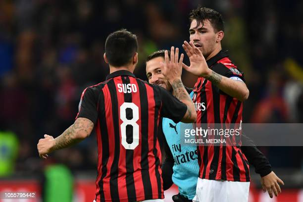 AC Milan's Italian defender Alessio Romagnoli celebrates with teammates after scoring a goal during the Italian Serie A football match between AC...