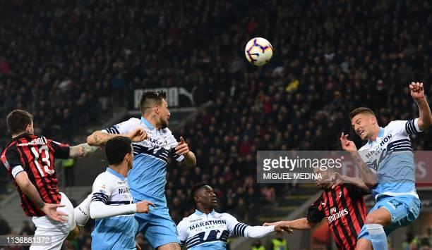 AC Milan's Italian defender Alessio Romagnoli Lazio's Italian defender Francesco Acerbi AC Milan's Italian forward Patrick Cutrone and Lazio's...