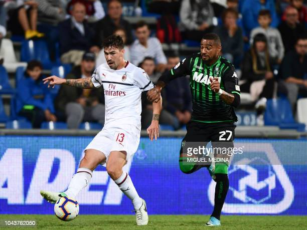 AC Milan's Italian defender Alessio Romagnoli pases the ball under pressure from Sassuolo's Ghanaian forward KevinPrince Boateng during the Italian...