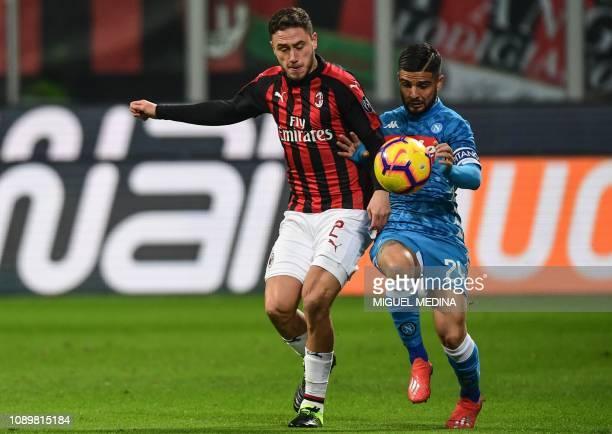 AC Milan's Italian defender Davide Calabria and Napoli's Italian forward Lorenzo Insigne go for the ball during the Italian Serie A football match AC...