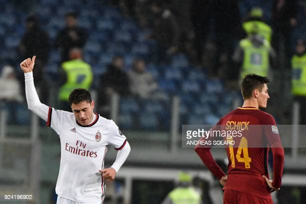 AC Milan's Italian defender Davide Calabria celebrates after scoring a goal during the Italian Serie A football match Roma versus Milan at the...