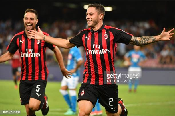 AC Milan's Italian defender Davide Calabria celebrates after scoring during the Italian Serie A football match Napoli vs AC Milan on August 25 2018...