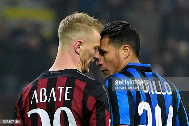 AC Milan's Italian defender Ignazio Abate argues with Inter Milan's Colombian defender Jeison Murillo during the Italian Serie A football match...