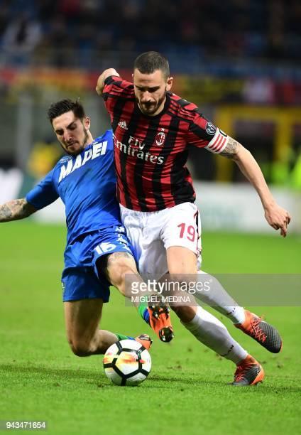 AC Milan's Italian defender Leonardo Bonucci vies with Sassuolo's Italian forward Matteo Politano during the Italian Serie A football match between...
