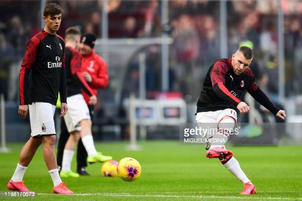 AC Milan's Italian forward Daniel Maldini and AC Milan's Croatian forward Ante Rebic warm up prior to the Italian Serie A football match AC Milan vs...