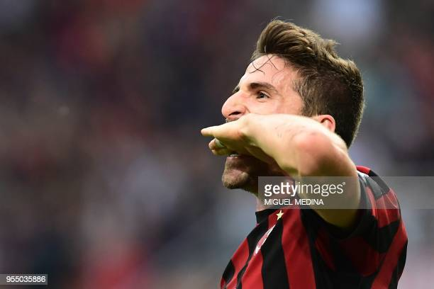 AC Milan's Italian forward Fabio Borini celebrates after scoring a goal during the Italian Serie A football match between AC Milan and Hellas Verona...