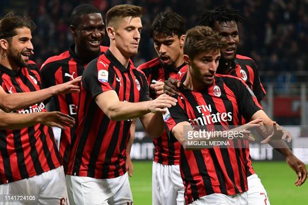 AC Milan's Italian forward Fabio Borini celebrates with teammates after scoring during the Italian Serie A football match AC Milan vs Bologna on May...