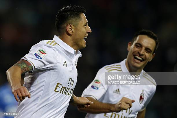 AC Milan's Italian forward Gianluca Lapadula celebrates after scoring a goal during the Italian Serie A football match between Empoli and AC Milan on...