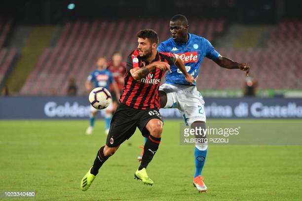 AC Milan's Italian forward Patrick Cutrone and Napoli's Senegalese defender Kalidou Koulibaly go for the ball during the Italian Serie A football...