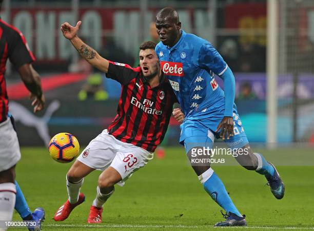 STADIUM MILAN LOMBARDIA ITALY Milan's Italian forward Patrick Cutrone fights for the ball with Napoli's Senegalese defender Kalidou Koulibaly during...