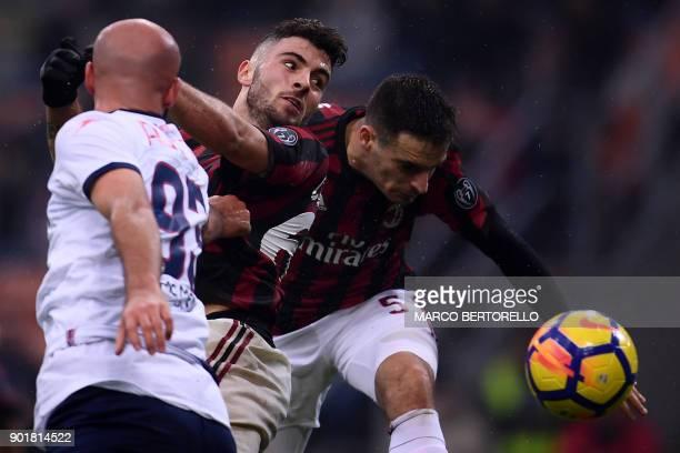 AC Milan's Italian forward Patrick Cutrone jumps for the ball with AC Milan's Italian midfielder Giacomo Bonaventura during the Italian Serie A...