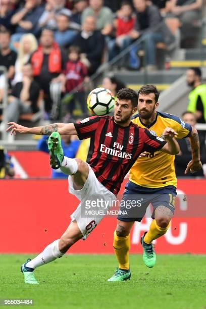 AC Milan's Italian forward Patrick Cutrone vies with Hellas Verona's Italian defender Antonio Caracciolo during the Italian Serie A football match...