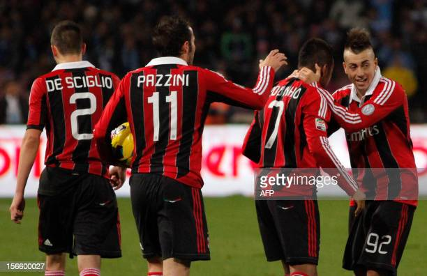 Milan's Italian forward Stephan El Shaarawi celebrates with teammates after scoring a goal during the Serie A football match between SSC Napoli and...