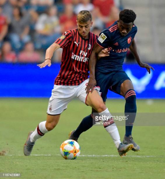 AC Milan's Italian foward Daniel Maldini vies for the ball with FC Bayern's French foward Kingsley Coman during their International Champions Cup...