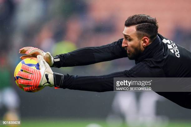 AC Milan's Italian goalkeeper Antonio Donnarumma takes part in a warm up before the Italian Serie A football match AC Milan Vs Crotone on January 6...