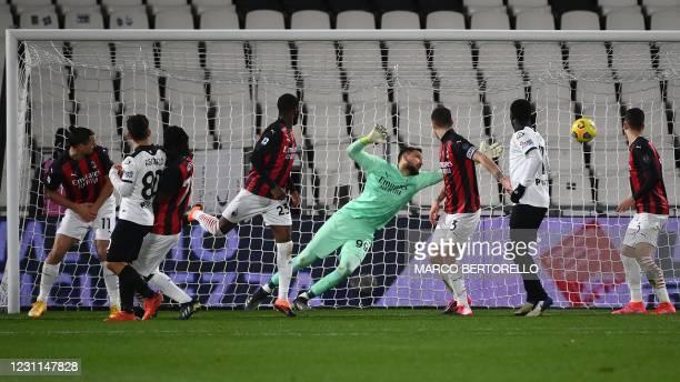 Milan's Italian goalkeeper Gianluigi Donnarumma concedes the second goal during the Italian Serie A football match Spezia vs AC Milan on February 13,...