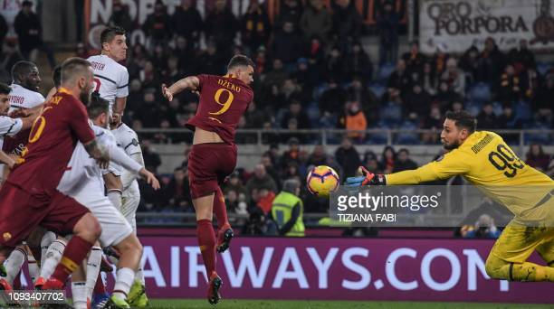 AC Milan's Italian goalkeeper Gianluigi Donnarumma deflects a shot to save a goal during the Italian Serie A football match AS Roma vs AC Milan on...