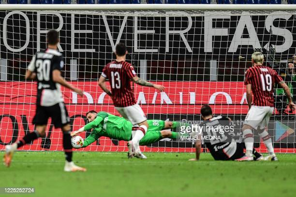 AC Milan's Italian goalkeeper Gianluigi Donnarumma dives to stop a shot from Juventus' Argentinian forward Gonzalo Higuain during the Italian Serie A...