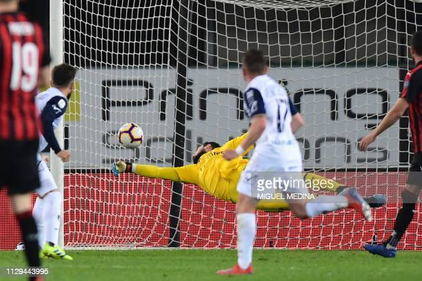 AC Milan's Italian goalkeeper Gianluigi Donnarumma fails to stop a header by Chievo's Finnish midfielder Perparim Hetemaj during the Italian Serie A...