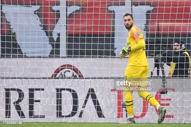AC Milan's Italian goalkeeper Gianluigi Donnarumma reacts after conceding the opening goal during the Italian Serie A football match AC Milan vs...