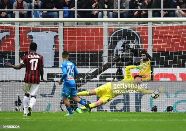 AC Milan's Italian goalkeeper Gianluigi Donnarumma stretches to catch the ball during the Italian Serie A football match AC Milan vs Napoli at San...