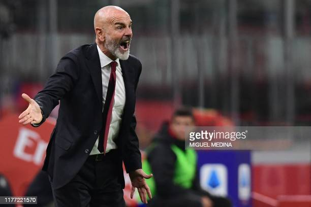 Milan's Italian head coach Stefano Pioli shouts instructions during the Italian Serie A football match AC Milan vs Lecce on October 20, 2019 at the...