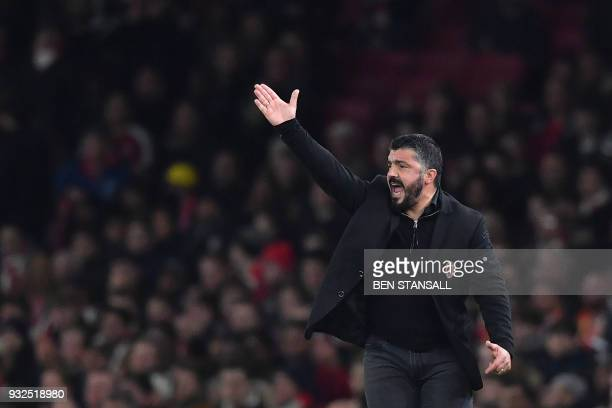 AC Milan's Italian manager Gennaro Gattuso gestures during the UEFA Europa League round of 16 secondleg football match between Arsenal and AC Milan...