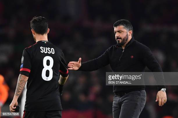AC Milan's Italian manager Gennaro Gattuso shakes hands with AC Milan's Spanish striker Suso at the final whistle during the UEFA Europa League round...