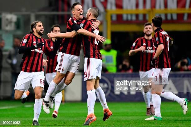 AC Milan's Italian midfielder Giacomo Bonaventura celebrates with AC Milan's Captain Italian defender Leonardo Bonucci and teammates after scoring a...