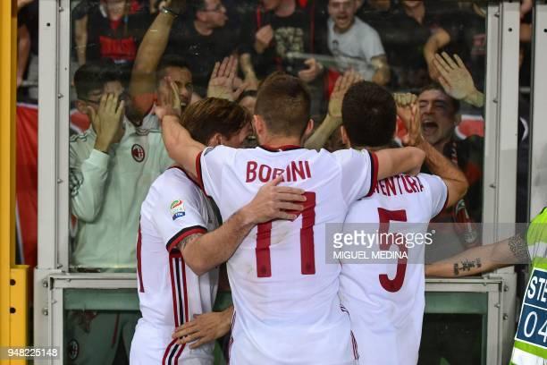 AC Milan's Italian midfielder Giacomo Bonaventura celebrates with AC Milan's Italian forward Fabio Borini and AC Milan's Argentinian midfielder Lucas...