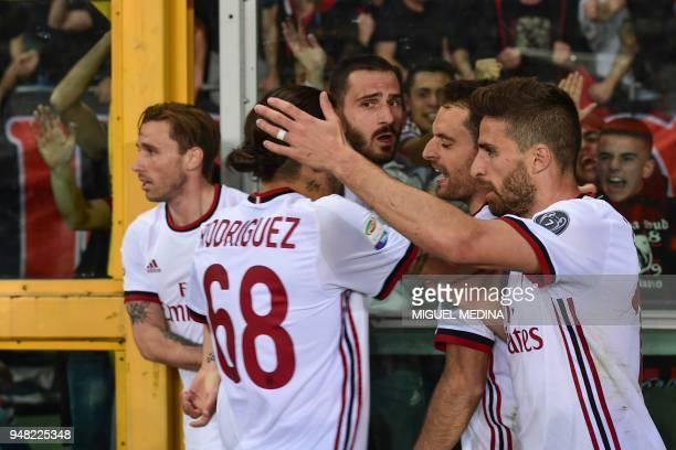 AC Milan's Italian midfielder Giacomo Bonaventura celebrates with AC Milan's Italian forward Fabio Borini AC Milan's Argentinian midfielder Lucas...