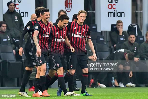 Milan's Italian midfielder Giacomo Bonaventura celebrates with teammates after scoring a goal during the Italian Serie A football match between AC...