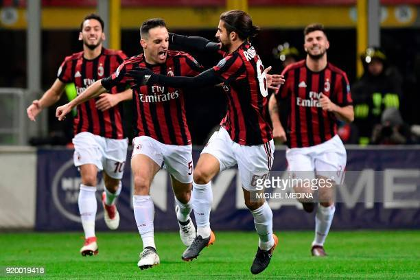 AC Milan's Italian midfielder Giacomo Bonaventura celebrates with teammates after scoring a goal during the Italian Serie A football match between AC...